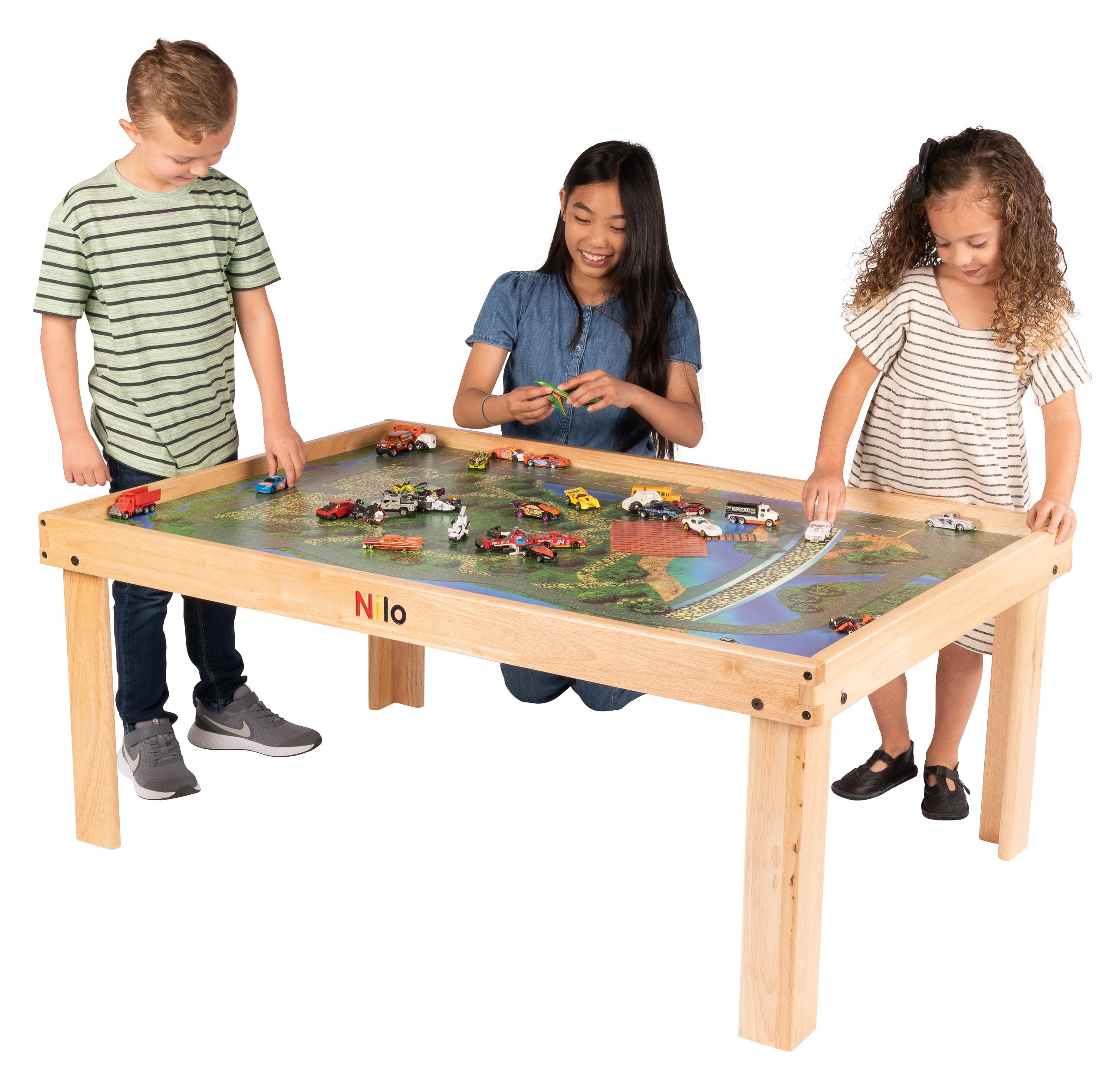 Kids playing with toy cars on the Nilo Large Childrens play table & Nilo Graphic mat.
